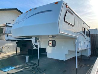 2000 Bigfoot Truck Camper 30C10.11FR Long bed, One owner, Onan Generator in Livermore, California 94551