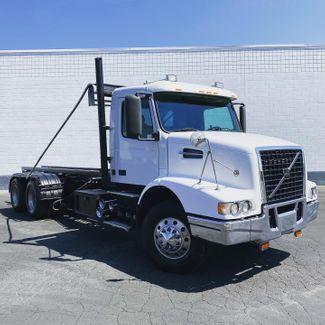 2002 Volvo VHD Roll Off Truck in Salt Lake City, UT 84104