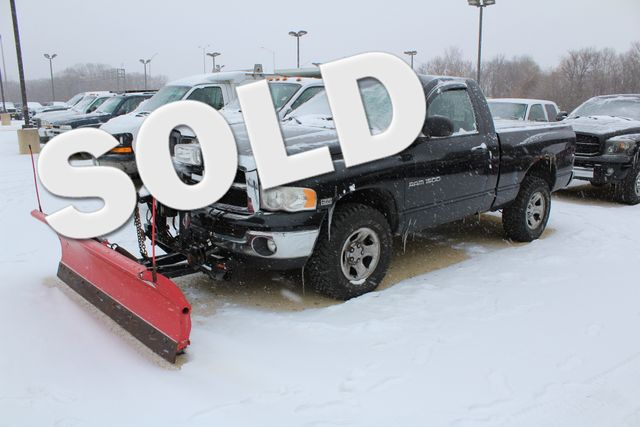 2004 Dodge Ram 1500 with a plow slt