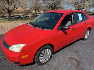 2006 Ford- 32 Mpg! Auto!! Focus-$2995 BUY HERE PAY HERE ZX4 SE-CARMARTSOUTH.COM in Knoxville, Tennessee 37920