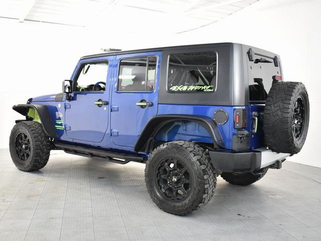 2009 Jeep Wrangler Unlimited Sahara CUSTOM WHEELS AND TIRES in McKinney, Texas 75070