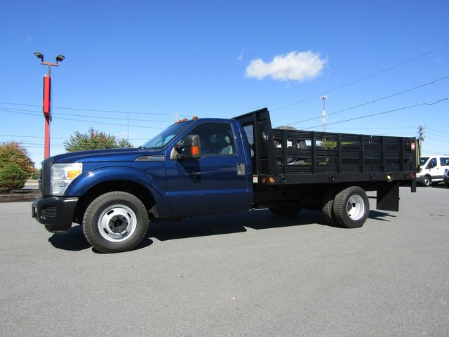 2011 Ford F350 12' Flatbed Stake Body with Lift Gate