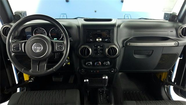 2011 Jeep Wrangler Unlimited Sport Custom wheels and tires in McKinney, Texas 75070