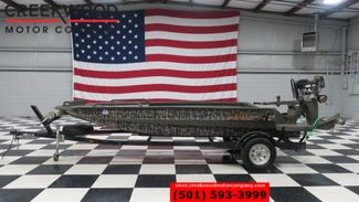 2012 Excel Viper F4 Camo 1651 Mud Buddy 36HP Motor in Searcy, AR 72143