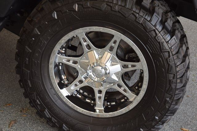 2012 Jeep Wrangler Unlimited Sahara Lift wheels and tires in McKinney Texas, 75070