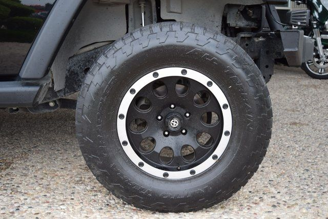 2012 Jeep Wrangler Unlimited Sport LIFTED W/ CUSTOM TIRES AND WHEELS in McKinney Texas, 75070