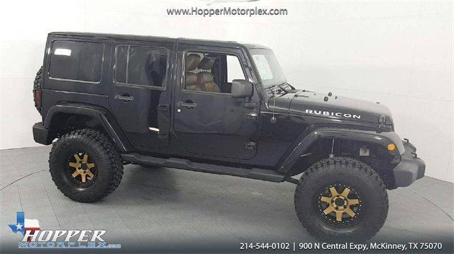 2012 Jeep Wrangler Unlimited Rubicon LIFTED W/CUSTOM TIRES AND WHEELS