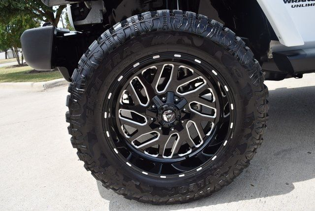 2013 Jeep Wrangler Unlimited Sahara LIFTED W/CUSTOM WHEELS AND TIRES in McKinney Texas, 75070