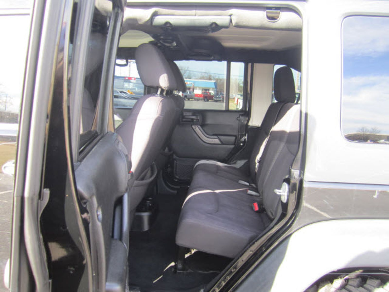 2013 Jeep Wrangler Unlimited Sport Fort Smith Ar Breeden Auto Sales Front Seat Cargo Cover In