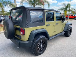 2013 Jeep Wrangler Unlimited SPORT CARFAX CERT  Plant City Florida  Bayshore Automotive   in Plant City, Florida