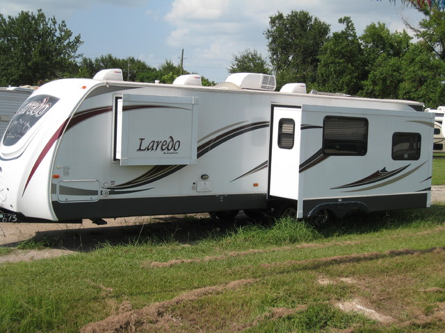 2013 For Rent- 30' Laredo Rear Living with Slideout
