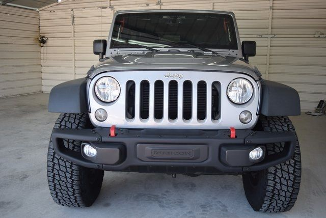 2014 Jeep Wrangler Unlimited Rubicon LIFTED W/CUSTOM TIRES AND WHEELS in McKinney Texas, 75070
