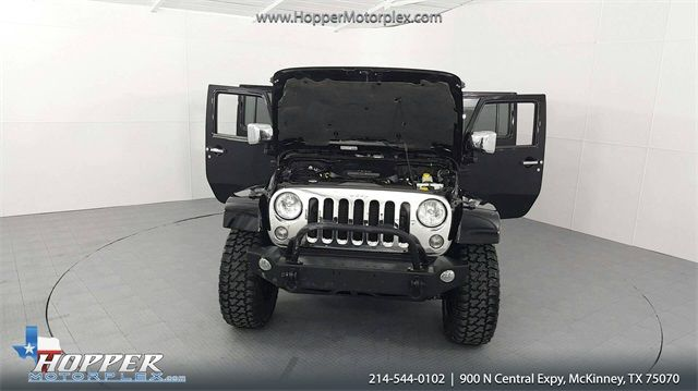 2014 Jeep Wrangler Unlimited Sahara LIFTED W/CUSTOM TIRES AND WHEELS in McKinney Texas, 75070