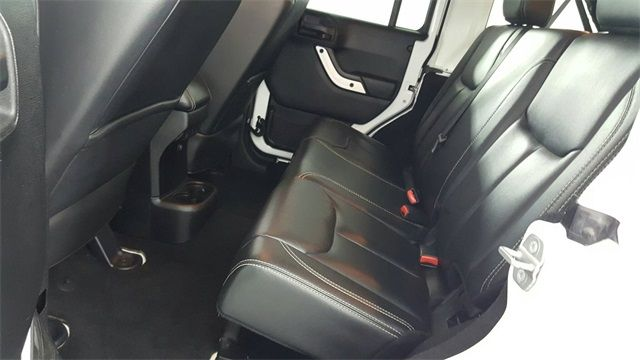 2014 Jeep Wrangler Unlimited Sahara LIFT/CUSTOM WHEELS AND TIRES in McKinney, Texas 75070