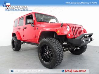 2014 Jeep Wrangler Unlimited Sahara lLIFT/CUSTOM WHEELS AND TIRES in McKinney, Texas 75070