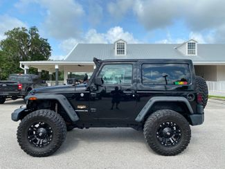2014 Jeep Wrangler DUAL TOP SAHARA LIFTED LEATHER NAV XD   Plant City Florida  Bayshore Automotive   in Plant City, Florida