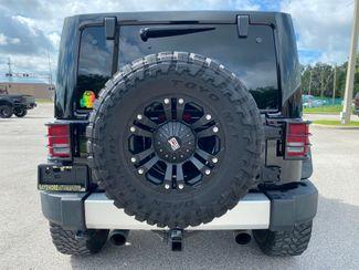 2014 Jeep Wrangler DUAL TOP SAHARA LIFTED LEATHER NAV XD   Plant City Florida  Bayshore Automotive   in Plant City, Florida