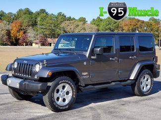2014 Jeep Wrangler Unlimited Sahara in Hope Mills, NC 28348