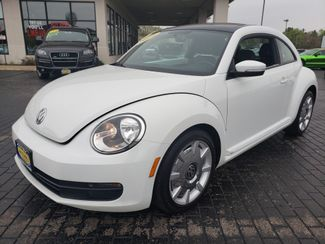 2014 Volkswagen Beetle Coupe 1.8T w/Sun/Sound/Nav | Champaign, Illinois | The Auto Mall of Champaign in Champaign Illinois