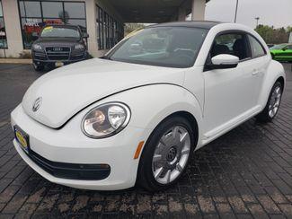 2014 Volkswagen Beetle Coupe 1.8T w/Sun/Sound/Nav | Champaign, Illinois | The Auto Mall of Champaign in Champaign Illinois