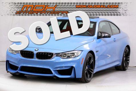 2015 BMW M4  - YAS MARINA BLUE METALLIC over SAKHIR ORANGE in Los Angeles