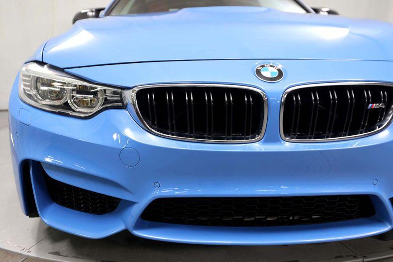 2015 BMW M4  - YAS MARINA BLUE METALLIC over SAKHIR ORANGE  city California  MDK International  in Los Angeles, California