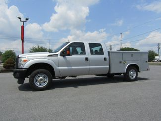 2015 Ford F250 Crew Cab 4x4 with 8' Reading Flip Top Utility Bed in Ephrata, PA 17522