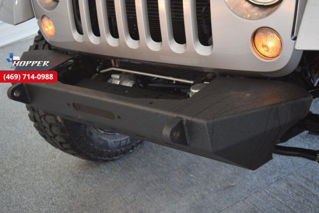 2015 Jeep Wrangler Unlimited Rubicon New lift with custom wheels a... in McKinney Texas, 75070