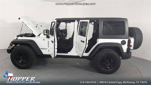 2015 Jeep Wrangler Unlimited Rubicon CUSTOM WHEELS AND TIRES in McKinney Texas, 75070