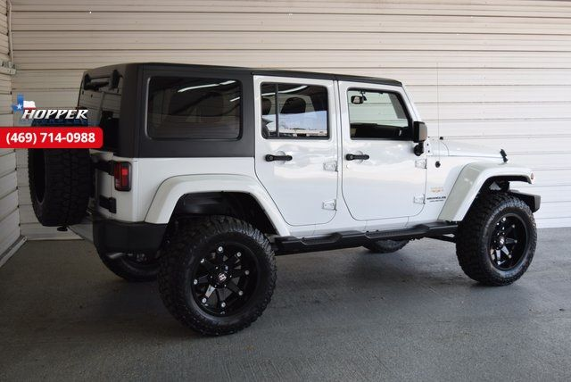 2015 Jeep Wrangler Unlimited Sahara New lift kit wheels and tires in McKinney Texas, 75070