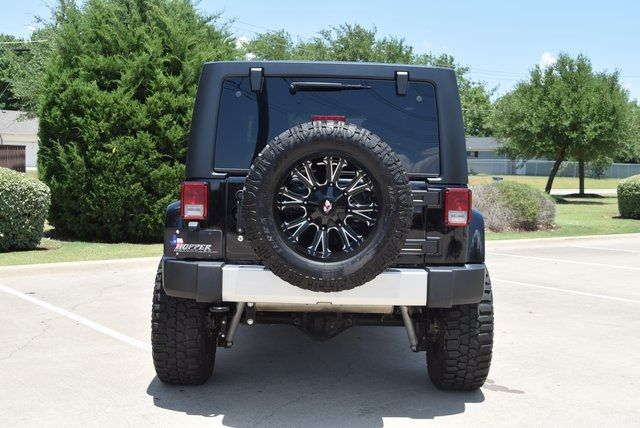 2015 Jeep Wrangler Unlimited Sahara LIFTED W/CUSTOM WHEELS & TIRES in McKinney Texas, 75070
