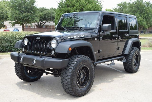 2015 Jeep Wrangler Unlimited Rubicon LIFTED W/CUSTOM TIRES AND WHEELS in McKinney Texas, 75070