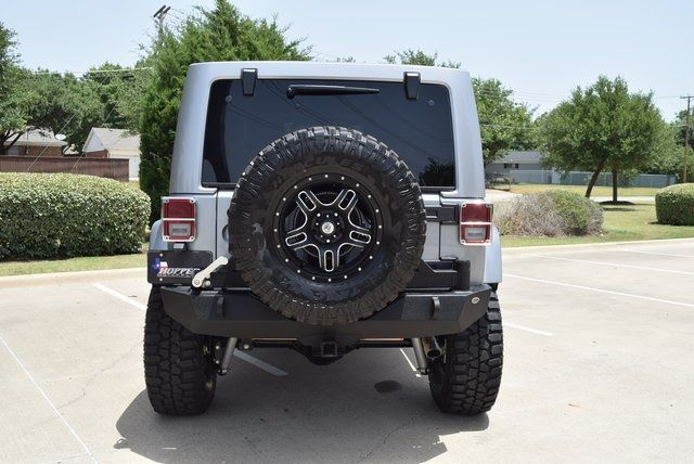 2015 Jeep Wrangler Unlimited Sahara LIFTED W/CUSTOM TIRES AND WHEELS in McKinney Texas, 75070