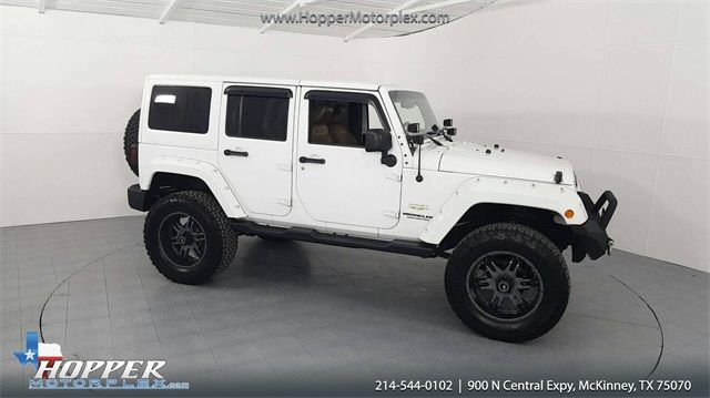 2015 Jeep Wrangler Unlimited Sahara LIFTED W/CUSTOM TIRES AND WHEELS