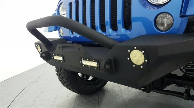 2015 Jeep Wrangler Unlimited Sahara LIFTED W/CUSTOM WHEELS AND TIRES in McKinney Texas, 75070