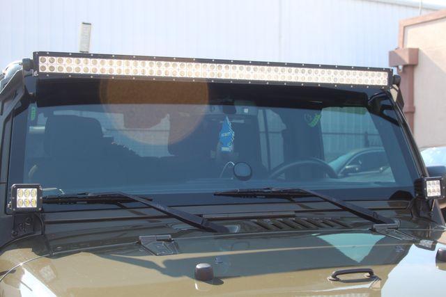 2015 Jeep Wrangler Unlimited Sport in Houston, Texas 77057