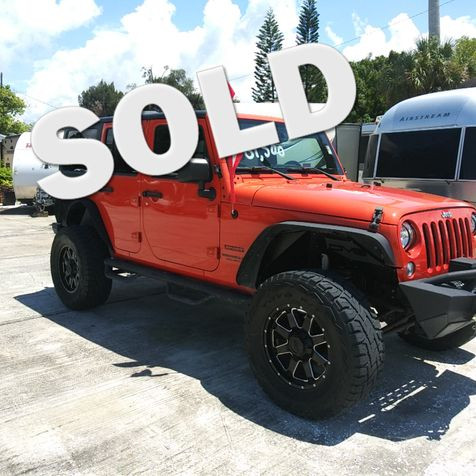 2015 Jeep Wrangler Unlimited Sport Lifted 35x12.5x20 tires in Palmetto, FL