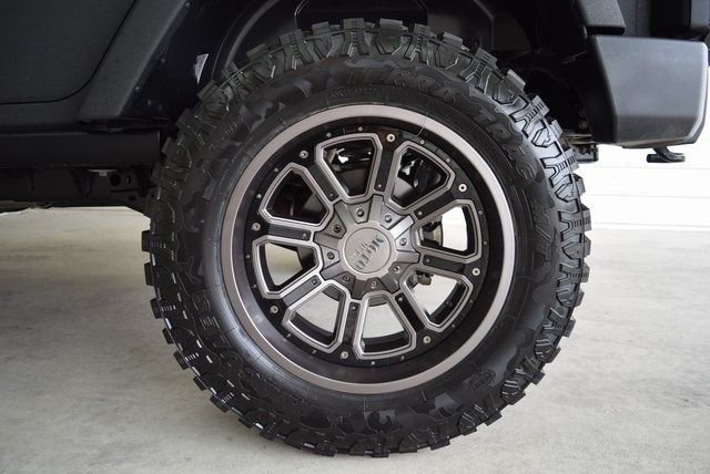 2016 Jeep Wrangler Unlimited Rubicon LIFTED W/ CUSTOM TIRES AND WH... in McKinney Texas, 75070