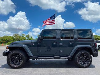 2018 Jeep Wrangler JK Unlimited ALTITUDE LEATHER SAHARA NAV DUAL TOP ALPINE  Plant City Florida  Bayshore Automotive   in Plant City, Florida