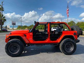 2019 Jeep Wrangler Unlimited AGENT ORANGE CUSTOM LIFTED SAHARA LEATHER    Florida  Bayshore Automotive   in , Florida