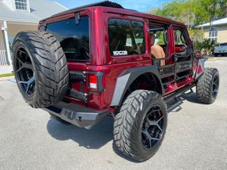 2021 Jeep Wrangler SNAZZBERRY DELUXE 1 TOUCH SKY TOP  Plant City Florida  Bayshore Automotive   in Plant City, Florida